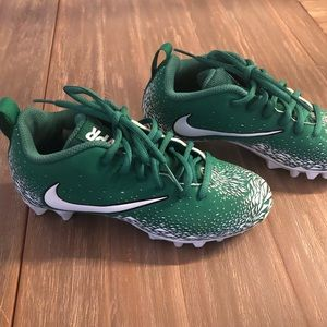 Nike boys cleats. Green, worn once. Size 2